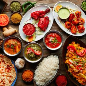 A collection of South African Indian foods, with many spices and herbs. The foods or rich in colour and flavour